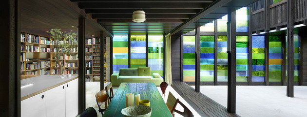 coloured glass walls sparkle from cottage addition 1 dining library thumb 630x242 29639 Cottage with Colored Glass Walls and Pre existing Trees