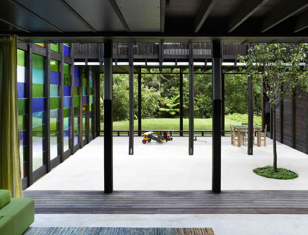 coloured-glass-walls-sparkle-from-cottage-addition-6-terrace.jpg