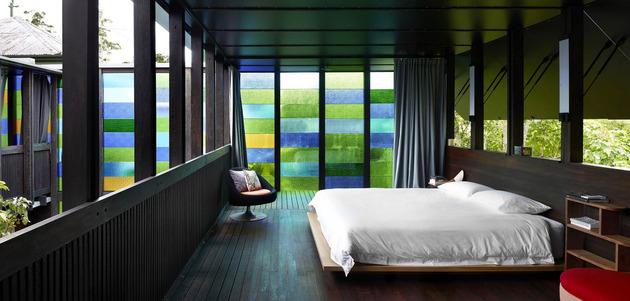 coloured-glass-walls-sparkle-from-cottage-addition-8-masterbedroom.jpg