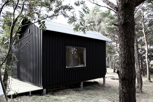 compact-plywood-pine-cabin-with-attached-sauna-3-bedroom-deck.jpg