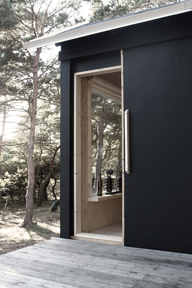 compact-plywood-pine-cabin-with-attached-sauna-6-sliding-door.jpg