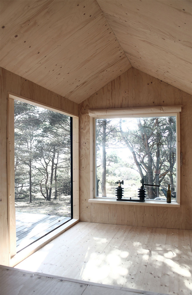 compact-plywood-pine-cabin-with-attached-sauna-8-living-room-open.jpg