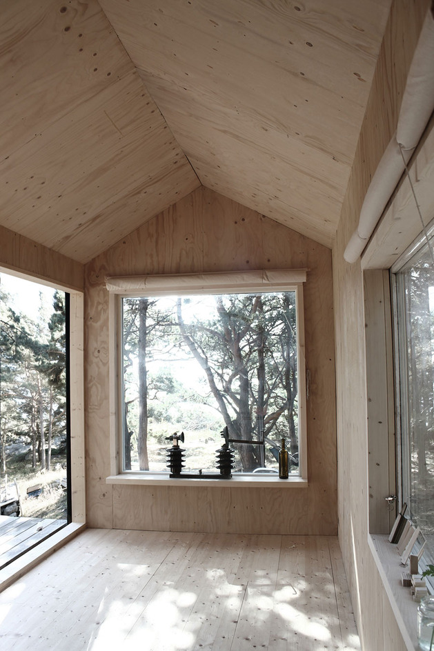 compact-plywood-pine-cabin-with-attached-sauna-9-three-windows.jpg