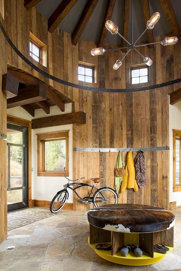 contemporary rustic residence industrial moments features turret 1 foyer thumb 630x945 27778 Turret Home with Rustic Interiors