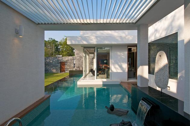 geometri architecture creates artistic minimalist statement 1 pool thumb 630x418 29494 Modern Minimalist Bungalow Design by Atelier dnD