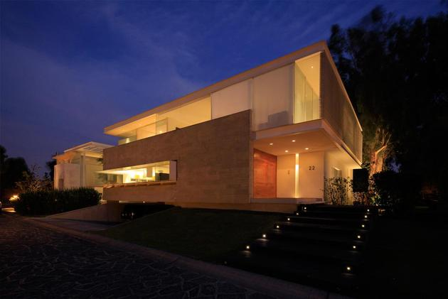 geometric-home-cantilevered-master-suite-overlooking-pool-16-entry-evening.jpg