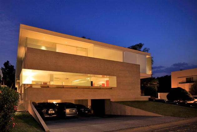 geometric-home-cantilevered-master-suite-overlooking-pool-17-garage-evening.jpg
