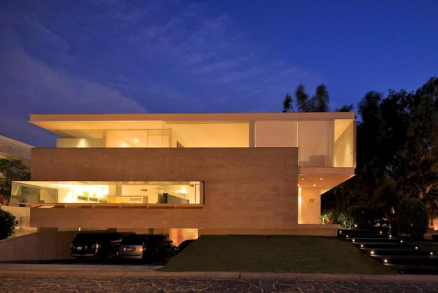 geometric-home-cantilevered-master-suite-overlooking-pool-18-garage-evening.jpg