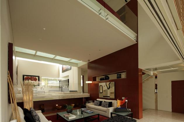 geometric-home-cantilevered-master-suite-overlooking-pool-6-living.jpg