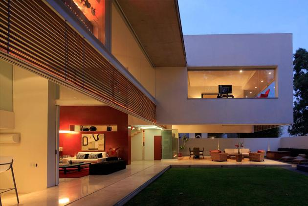 geometric-home-cantilevered-master-suite-overlooking-pool-7-glass-walls.jpg