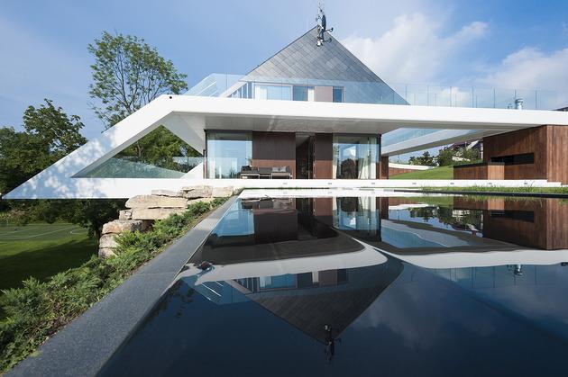 geometric home emerges lime cliff 1 concrete framework thumb 630x419 27870 Slanted Roof Line Home