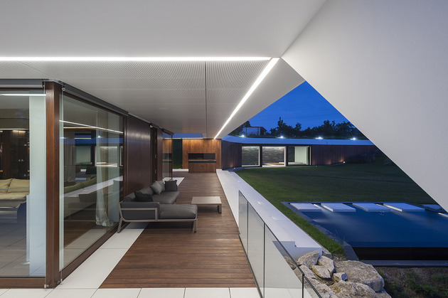 geometric home emerges lime cliff 2 pool terrace thumb 630x419 27872 Slanted Roof Line Home