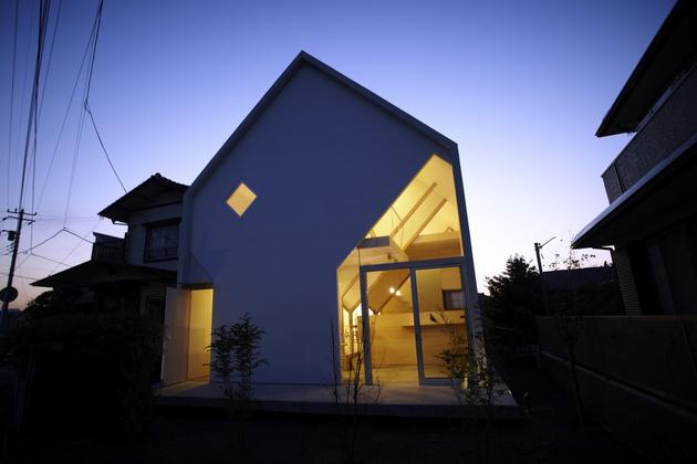 japanese-home-big-roof-8- large-y-supports-21-front-view-dusk.jpg