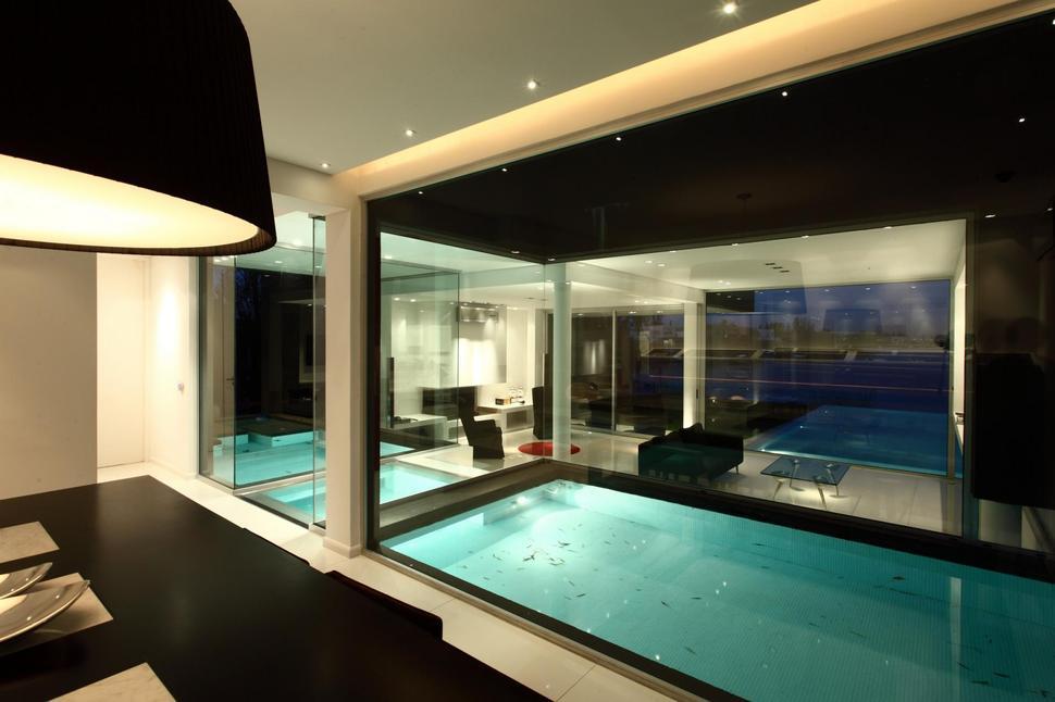 View in gallery lakeside black house views pools glass bridge 8
