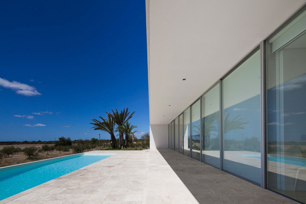 minimalist-white-house-with-glass-walkway-in-olive-grove-19.jpg