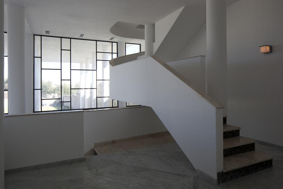 Modern Hacienda Style Home Built on Pillars on
