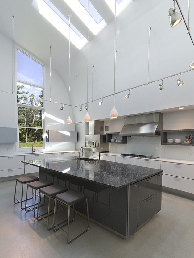 modern-massachusetts-woodland-house-with-two-story-ceilings-9-kitchen-ceilings.jpg