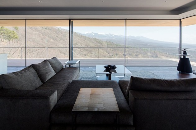 mountain-home-glass-walls-and-terrace-made-for-views-12.jpg