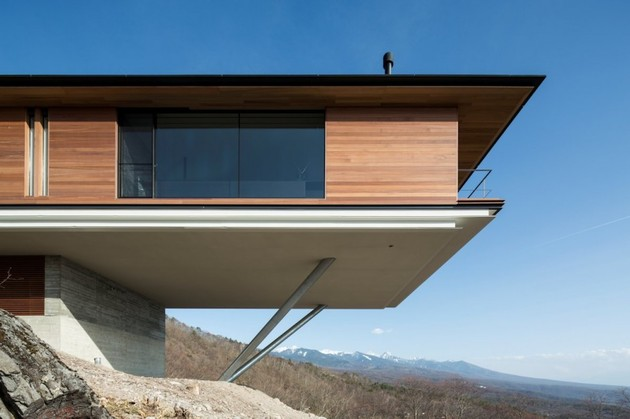 mountain-home-glass-walls-and-terrace-made-for-views-7.jpg