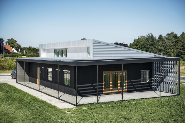 passive house made from shipping containers and recycled materials 2 thumb 630x420 29804 Upcycle House: Two Prefabricated Shipping Containers, Recycled Soda Cans
