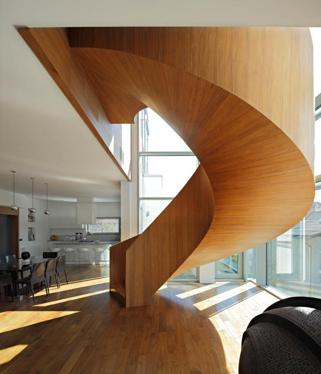 sculptural circular stairwell focus minimalist residence 1 stairwell thumb 630x734 29470 Concrete Circular Stairwell Focus of Minimalist Residence