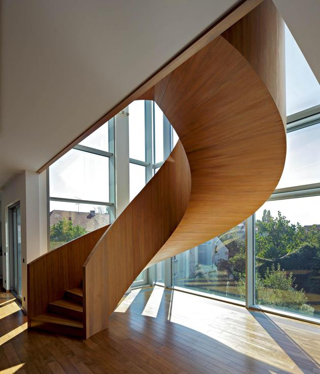 sculptural-circular-stairwell-focus-minimalist-residence-10-stairs.jpg