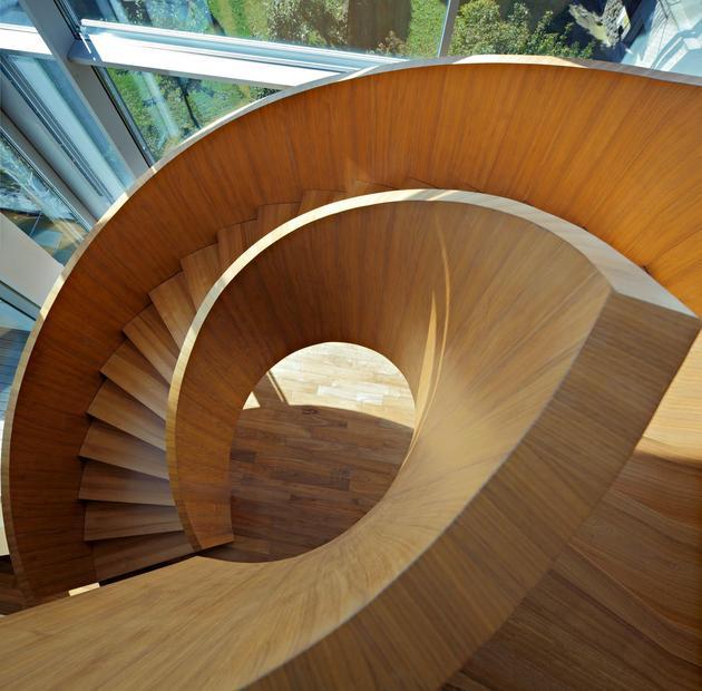 sculptural-circular-stairwell-focus-minimalist-residence-11-stairs-above.jpg