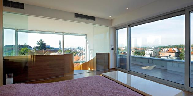 sculptural-circular-stairwell-focus-minimalist-residence-12-master-suite.jpg