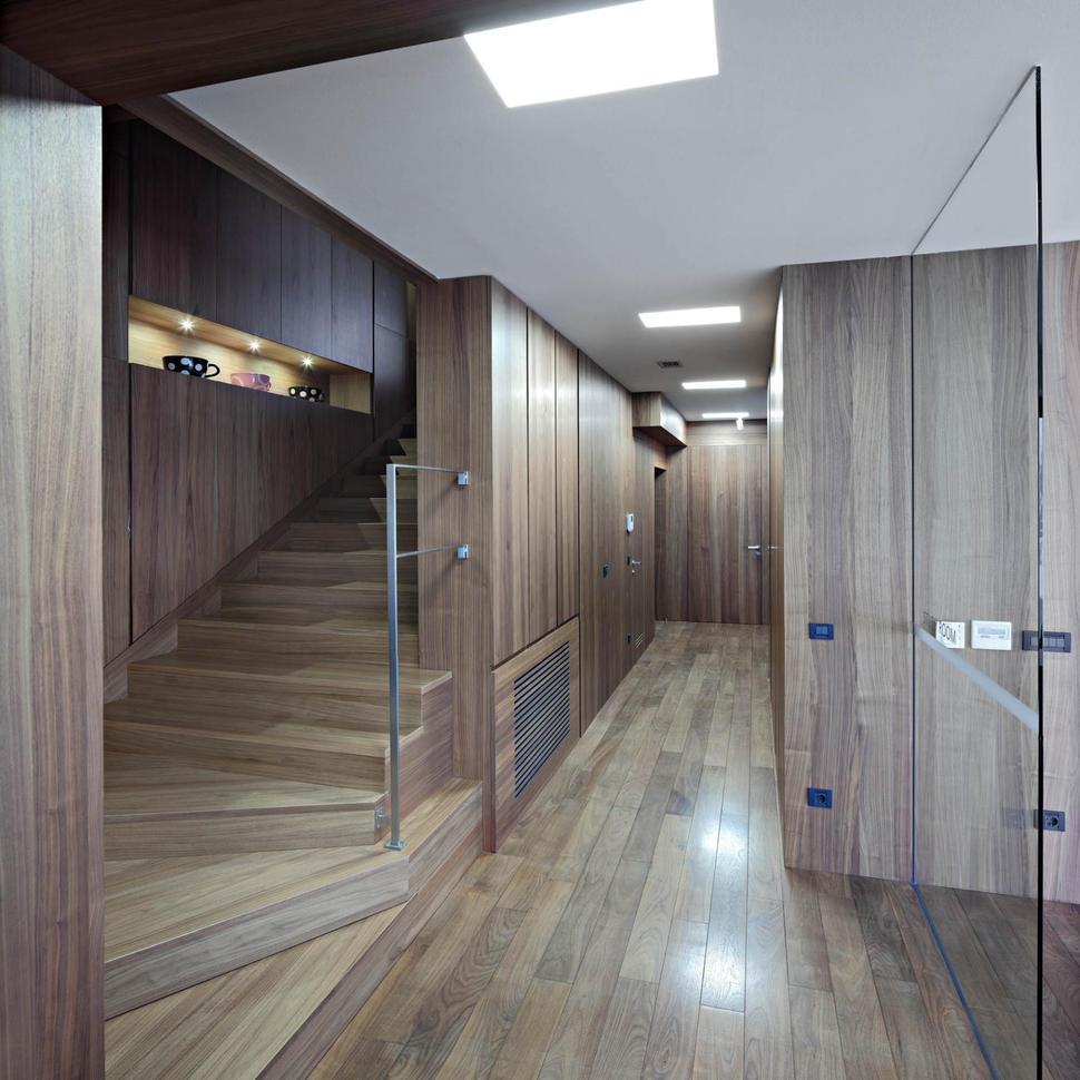 Interior Foyer Minimalist : Concrete circular stairwell focus of minimalist residence