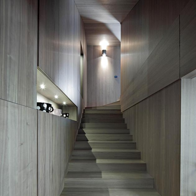 sculptural-circular-stairwell-focus-minimalist-residence-7-foyer-stairs.jpg