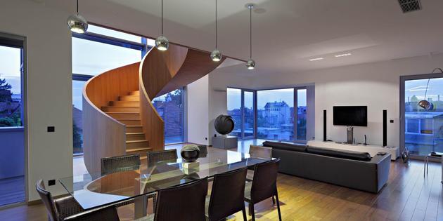 sculptural-circular-stairwell-focus-minimalist-residence-8-social-volume.jpg