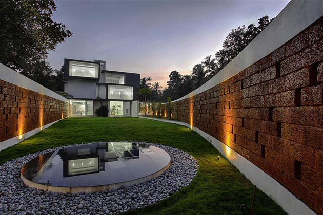 shielded house design features privacy walls and luxurious interiors 1 thumb 630x420 29934 House with Privacy Brick Walls
