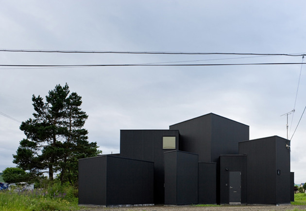 small-house-big-impact-with-black-facade-white-interiors-4.jpg