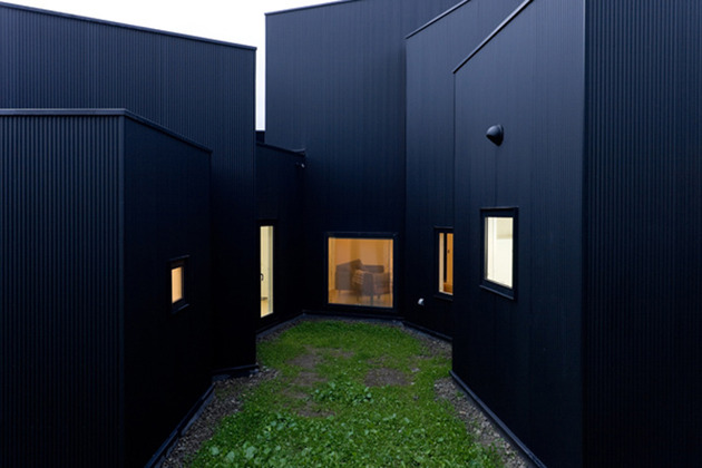 small-house-big-impact-with-black-facade-white-interiors-5.jpg