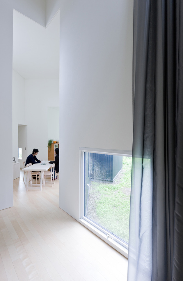 small-house-big-impact-with-black-facade-white-interiors-8.jpg