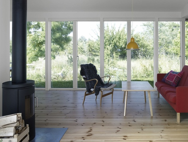small-swedish-house-made-from-boards-corrugated-metal-10-living-area.jpg