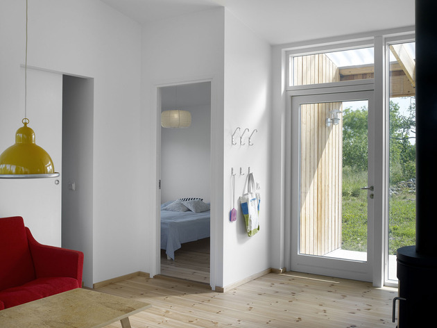 small-swedish-house-made-from-boards-corrugated-metal-11-bedroom-entrance.jpg