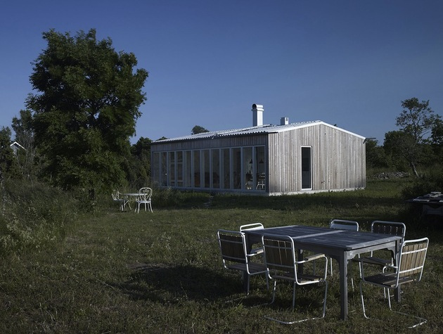 small-swedish-house-made-from-boards-corrugated-metal-3-rear-angle.jpg