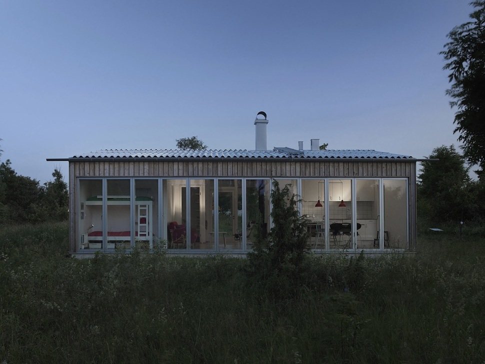 Small swedish house made from boards and corrugated metal for Tin roof house designs