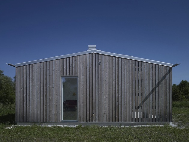 small-swedish-house-made-from-boards-corrugated-metal-6-side.jpg