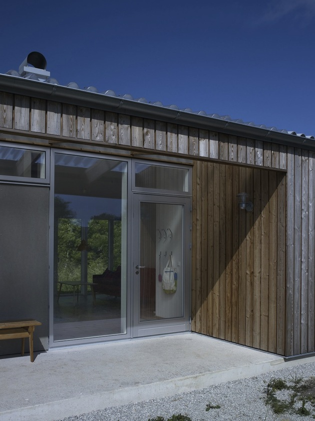 small-swedish-house-made-from-boards-corrugated-metal-7-front-door.jpg