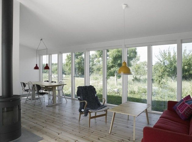 small-swedish-house-made-from-boards-corrugated-metal-9-main-room.jpg