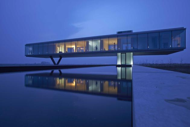 striking minimal glass house elevated above barren landscape 1 upper half pool thumb 630x420 26663 House With Two Volumes: One Above Ground, One Underground