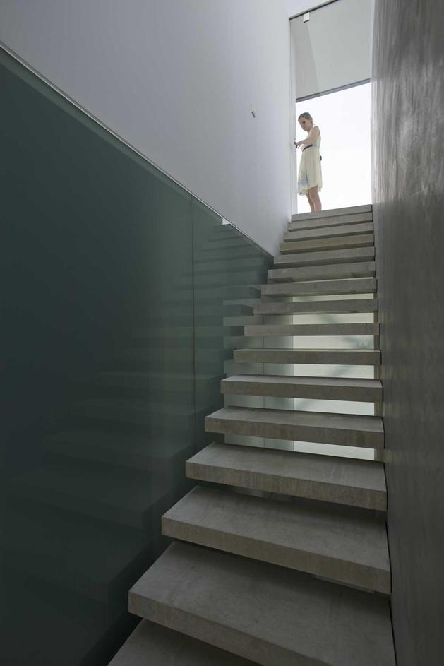 striking-minimal-glass-house-elevated-above-barren-landscape-5-staircase-inside.jpg