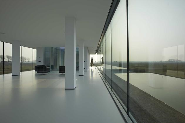 striking-minimal-glass-house-elevated-above-barren-landscape-7-interior-glass-wall.jpg