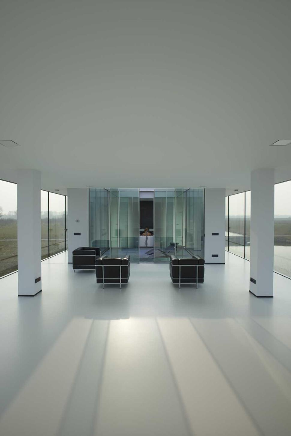 House With Two Volumes One Above Ground One Underground