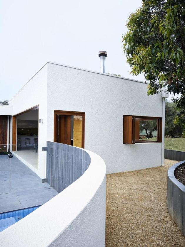 summer-house-expansion-creates-private-courtyard-11-pool-wall.jpg