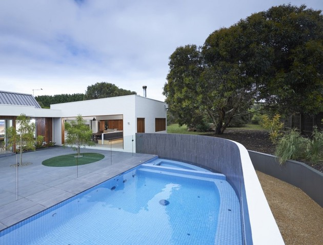 summer-house-expansion-creates-private-courtyard-13-pool.jpg