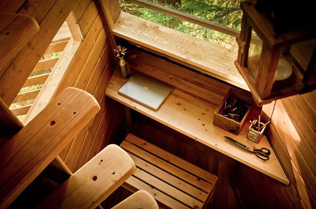 suspended-wooden-pod-cabin-built-around-tree-trunk-15-desk-stairs.jpg