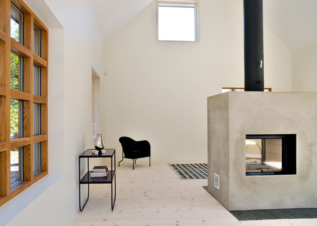 swedish-loft-house-with-concrete-fireplace-feature-3.jpg